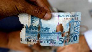 Gambar dan syarat penukaran uang rusak